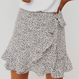 Black and white tulip wrap skirt